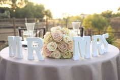 Cute Sweetheart Table idea, but a little too 'in your face' for me
