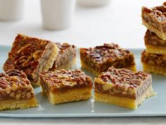 """Ina's Pecan Squares: When we want to go """"over the top"""" we dip half of each square in warm chocolate. #Thanksgiving #ThanksgivingFeast #Dessert"""