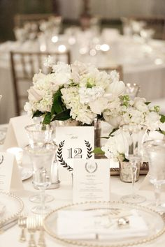 classic white centerpieces Photography by Leslee Mitchell / lesleemitchell.com/blog, Event Planner by The Posh Planner / theposhplanner.com/index2.php, Floral Design by Holly Chapple Flowers / hollychappleflowers.com/index2.php #Centerpieces #White