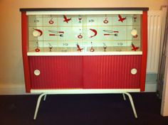 Wallpaper lined retro atomic display cabinet