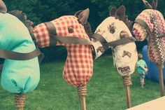 LOVE these homemade stick horses in red-and-turquoise motif - must recreate!