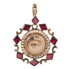 """Lover'e Eye"" Pendant with Natural Pearls and Foiled Garnets."