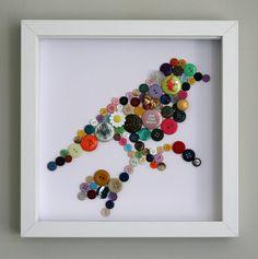 simple and sweet. a bird made of colorful buttons in a shadow box frame. tweet, tweet, tweet. <3
