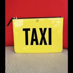 """New Kate Spade Taxi/Off Duty Gia Clutch Fun Kate Spade clutch. One side says """"Taxi"""" and the other  side says """"Off Duty"""". It also has fun  interior striped lining with shiny patent leather. Brand new without tag. kate spade Bags Clutches & Wristlets"""
