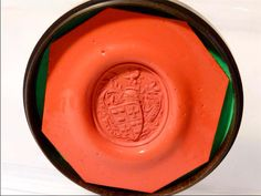antique red wax seal with a Livery, Peerage coat of arms...a LION at the top with the coat of arms and Latin motto ... DEO PARIAE AMICIS...  It comes in a circular LIGNUM VITAE box.