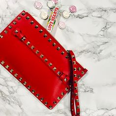"631 Likes, 5 Comments - Cricket Fashion (@cricketfashion) on Instagram: ""Roses are red, but nothing beats Valentino Red❤️ A classic Rockstud Pouch is the answer, we're open…"""