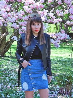 black biker jacket and denim skirt