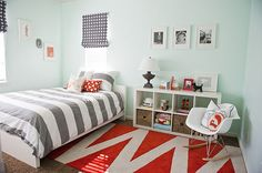 Red, grey, and light turquoise boy's room