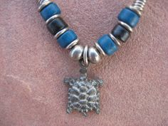 Pewter Turtle Necklace on Genuine Leather Black Strand and Ceramic Beads, Turtle Necklace by buffalorunjewelry on Etsy