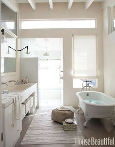 Juxtaposition of clean contemporary lines and vintage tub