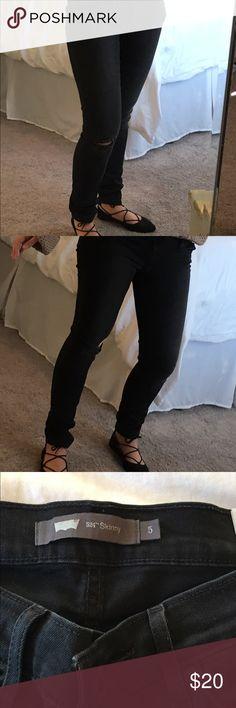 Black ripped Levi skinny jeans Black ripped Levi skinny jeans, size 5 only worn once! Levi's Jeans