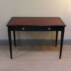 Desks / Games Tables - A circa 1950s, small French ebonised desk in the Louis XVI taste, with two single drawers and two brushing slides, that will work well in most settings.  Measurements: 110cm Wide (closed) x 174cm Wide (open) x 76cm High x 63cm High (leg room) x 60cm Deep  France Circa 1950s