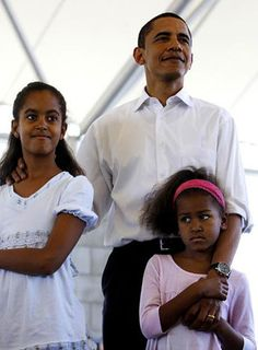 """Barack held Malia, 9, and Sasha, 7, at an event in Fort Wayne, Indiana on May 4. """"When I call them, they say, 'Daddy, what did you do today?' I say, 'Well, I spoke to 35,000 people,'"""" Obama said in April. """"[They respond] like, 'Boring!'"""""""