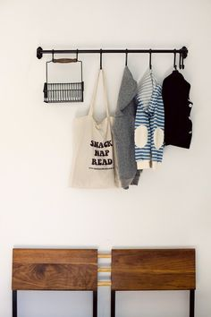 Coat rack: IKEA Fintorp hook, rail and hanging wire basket via A Cup of Jo / Los Angeles Home Tour