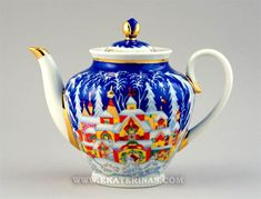 Lomonosov Winter Tale pattern Russian porcelain teapot  ... depicts red and yellow houses in snowy winter setting under bright blue sky, w/ 22 karat gold highlights, Saint Petersburg, Russia