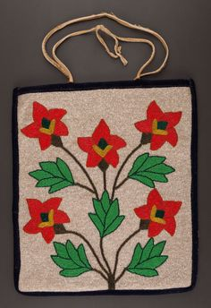 A PLATEAU BEADED HIDE FLAT BAG,    contour beaded in various shades of opaque and translucent glass seed beads, decorated on the front with a bold floral/foliate spray, backed with black wool and lined with printed cotton cloth,, hide handles, with old tag attached, inscribed Mae Olney, Oregon girl, Grad about 1936