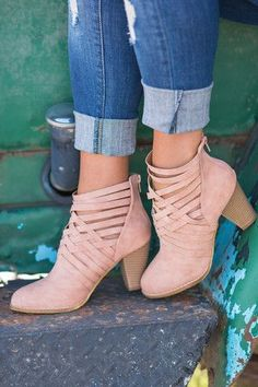 Love the pale pink color of these booties and the criss-cross lacing (source: www.nudevotion.com)