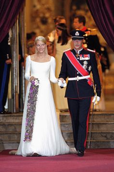 Norwegian Crown Prince Haakon and Princess Mette-Marit arrive for their wedding in Oslo, August 2001.   - HarpersBAZAAR.com