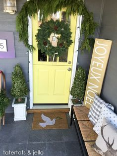 Easy and festive Christmas porch and entryway! Love the natural elements in this holiday decor and the plaid touches in the entryway!