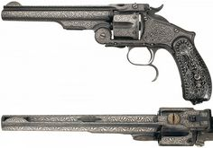 Ottoman government contract Smith and Wesson .44 Henry Rimfire caliber revolver, supplied to the military in the early 1870's and were converted from .44 Russian caliber by Smith & Wesson prior to shipment to meet the terms of the 5,000-gun contract. The revolver was subsequently decorated in the period of use with nearly full coverage of vine and geometric silver damascene inlay. The only areas not covered are the barrel and cylinder flutes and the outer edging.