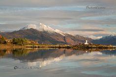 Isle Ornsay Lighthouse and Beinn Sgritheall in Winter. Eilean Iarmain. Isle of Skye. Scotland.