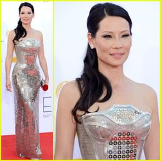 Lucy Liu dolled up in an Atelier Versace gown, Lorraine Schwartz jewelry, and Guiseppe Zanotti shoes and a clutch.