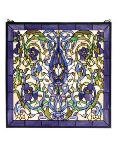 22 Inch W X 22 Inch H Floral Fantasy Stained Glass Window - 22 Inch W X 22 Inch H Floral Fantasy Stained Glass WindowRibbons and leaves of Green and Plum Blue twinearound lovely Violet flowers on an Ivory background.Made of 680 pieces of hand cut stained glass, this lovely Tiffany style window is handcrafted utilizing the copper foil construction process. A solid brasshanging chain and brackets are included. Theme: FLORAL NOUVEAU Product Family: Floral Fantasy Product Type: WINDOWS Product…