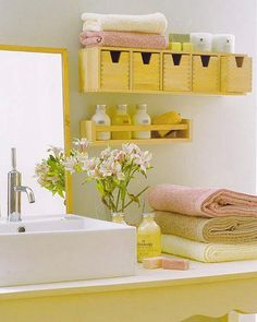 Bathroom shelf under main cabinet or maybe wicker baskets (long and narrow) or wire baskets painted - fabric covered, check dollar stores-could use larger baskets for hand towels