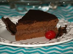Chocolate Boston Cream Pie Recipe is filled with a chocolate custard. Bake in a 10 inch spring form pan for 45 to 50 minutes. When cool split in 2 layers and fill with chocolate custard. Spread chocolate glaze over the top and sides.