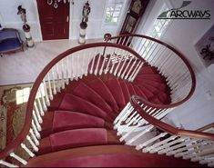 #5c Stair Design Arcways dramatic 'S' shaped freestanding cherry stairway with bowed treads viewed from 2nd floor balcony.