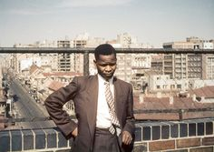 Oliver Tambo, former President of the African National Congress, on the roof of Ahmed Kathrada's apartment in 1953. Photo: Herb Shore, courtesy of Have You Heard From Johannesburg (www.clarityfilms.org)