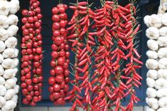 Central Hall Market Budapest  Peppers and garlic hanging from a stall. Air-drying spices is an old tradition in Hungary.