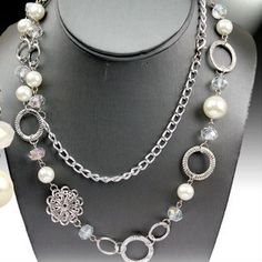 One Faith Boutique - Cream Long Strand Pearl and Charm Necklace, $16.00 (http://www.onefaithboutique.com/jewelry-accessories/cream-long-strand-pearl-and-charm-necklace/)
