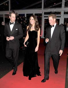 """Remembering the armed forces (From L-R) Britain's Prince William, Catherine, Duchess of Cambridge and Prince Harry leave after attending """"A Night of Heroes,"""" a gala to honor members of the British armed forces in London on Dec. 19, 2011."""