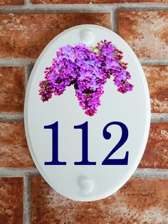 A range of pottery style house plaques feature prints of original artwork from our own sign artists. Hand cast in cultured marble these number plates are weatherproof outdoors. House Plaques, House Number Plaque, House Numbers, Lilac Flowers, Floral Motif, Decorative Plates, Pottery, Tableware, Home Decor