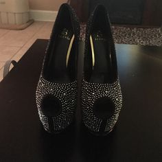 Beautiful sparkly black heels these have never been worn before. I bought these for prom but they ended up being too tall for me. they are a size 6 and are super tall!! the heel height is 6 inches. they are brand new! Shoes Heels