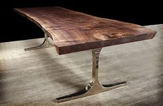 Love this walnut slab and brass base table from Hudson Design.