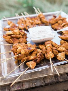 Wedding Food Moroccan chicken skewers and mint yogurt sauce wedding reception appetizer - From prosciutto-wrapped persimmons to grilled cheese and tomato soup shooters, these apps are sure to delight. Wedding Reception Appetizers, Cocktail Wedding Reception, Wedding Buffet Food, Wedding Catering, Easy Wedding Food, Wedding Meals, Wedding Canapes, Wedding Food Bars, Party Food Buffet