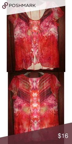 "One World Plus 1X Stretch Top Short Sleeve Beaded Size 1X pullover stretch top from One World.  Short cap sleeves that are semi sheer and different fabric from most of body of top.  Most of the top is not sheer.  Some has a liner so that it is not sheer.   Rounded neckline with beading beneath and cinched elastic below the bust.  Blend of reds and pinks with brown, black, off white, etc...  Very good condition. 22""/44"" bust with good amount of stretch,  31"" long in back and about 28"" long in…"
