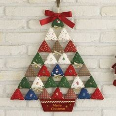 me ~ Christmas tree decoration. Very simple, 15 stuffed triangles with small baubles hanging between. Christmas Patchwork, Fabric Christmas Ornaments, Fabric Christmas Trees, Hanging Christmas Tree, Christmas Makes, Felt Christmas, Handmade Christmas, Christmas Tree Decorations, Christmas Holidays