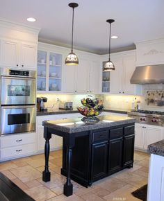 I LOVE this kitchen! It's a DIY, they painted the cabinetry, added height above the cabinets, and thick crown molding using double stacked baseboard and crown on top of baseboard. Good tutorial also.