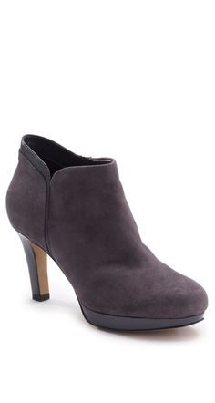 """These Clarks """"Delsie Stella"""" Dress Booties feature an OrthoLite footbed, side zipper and composition rubber outsoles that make them easy to wear. With its graceful heel, this women's platform boot looks smart with tights and a skirt."""