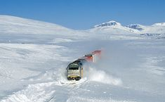"""""""Euro 4000"""" (road number 312 006) plowing through snow drifts at about 100 km/h. The train is an intermodal freight-train from Bodø towards Trondheim. The picture was taken on the Saltfjellet between Lønsdal and Bolna, Norway. (POTD);  Credit: David Gubler (Kabelleger / bahnbilder.ch)."""
