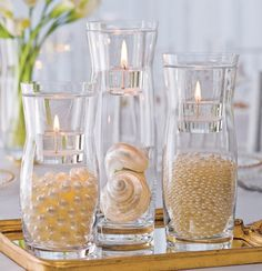 vases filled with pearls. I love the candle addition.
