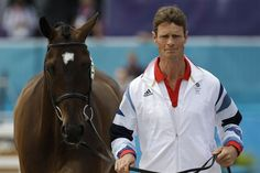 Great Britain's William Fox-Pitt runs with his horse Lionheart during horse inspection for the equestrian eventing competition at Greenwich Park July 27.