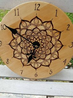 This 10 inch wide clock has a hand drawn Mandala that is then burned into the wood. It is stained in classic oak and sealed in a glossy