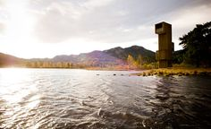 Seljord Watchtower by Rintala Eggertsson, Norway.  The 12m tall tower appears like a wooden periscope, poking up from the shrubs on the waterside, offering unbroken views down a long stretch of water.