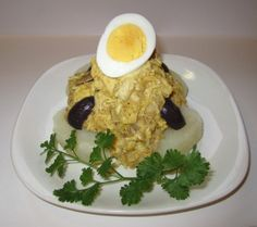 """""""Ají de gallina is the quintessential Peruvian dish:  it is a perfect fusion of Andean and European cuisines. It has roots in pre-Columbian times;  the Inca people cooked a breed of chicken called the """"hualpa"""" (which was renamed after Atahaulpa, the last Inca ruler executed by the Spanish) with a hot pepper called """" Ají amarillo. """""""