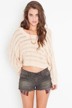 gives me an idea - sew patterned pockets on jean shorts    Baja Cutoff Shorts - Black