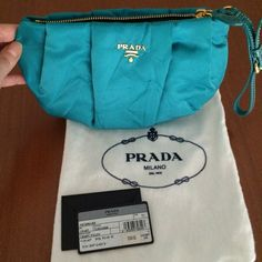 Prada Nylon Wristlet Clutch in Turquoise Blue Prada wristlet in turquoise blue.  New with tags, this cute Prada clutch is great for a night out on the town or brunch.  Have fun with color.  It has gold hardware and a patent leather strap.  It's 6 inches top to bottom and the widest part is 9 inches across.  Strap is 6 inches in length.  Purchased at Saks Fifth Avenue.  Never been worn. NWT Prada Bags Clutches & Wristlets